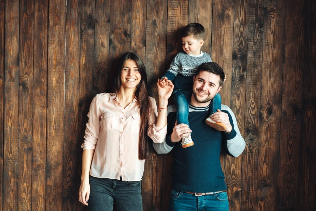 young family having fun at home